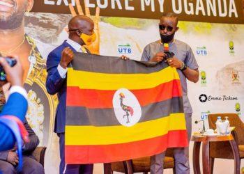 Minister Kiwanda Suubi unveiling singer Eddy Kenzo as  Uganda Tourism ambassadorial (PHOTO/Courtesy).