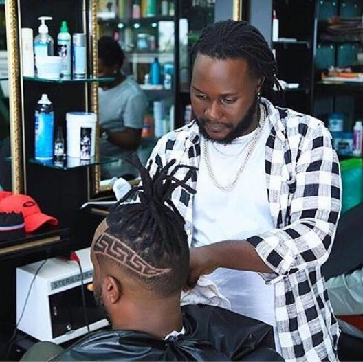 Mat barber cutting Bebe Cool hair (PHOTO/Courtesy).