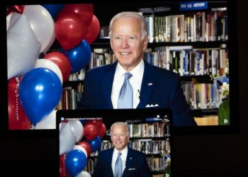 U.S. Democratic presidential nominee and former Vice President Joe Biden reacting in a video feed from Delaware is displayed on screens in Arlington, Virginia, the United States, on Aug. 18, 2020 (PHOTO/Xinhua).