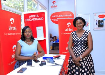 Airtel Uganda Customer Services Director, Lynda Nabayiinda (left) and PR Manager Sumin Namaganda launch Airtel's Customer Service Week at the premium shop in Wampewo (PHOTO/Courtesy).