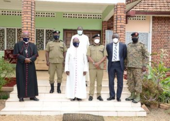 Bishop John Baptist Kaggwa in a group photo with a visiting police delegation led by AIGP Asante Kasingye (PHOTO/Courtesy).
