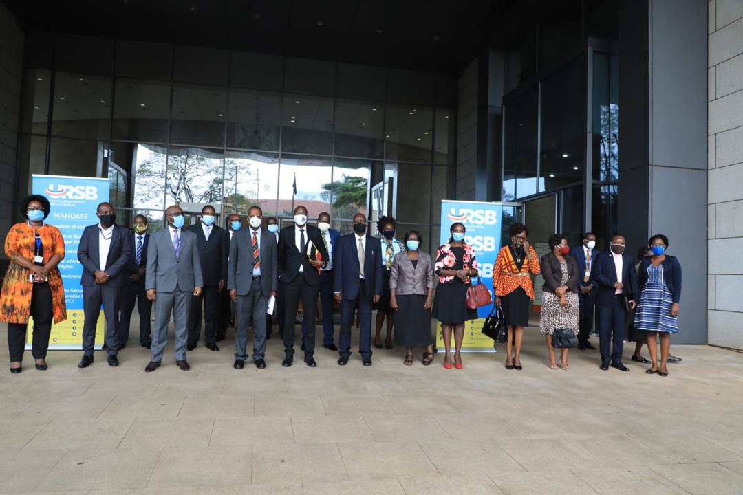 Minister of Justice & Constitutional Affairs, Prof Ephraim Kamuntu (c), Deputy Attorney General, Hon. Jackson Kafuzi (5th L), Registrar General, Bemanya Twebaze (3rd L) pose with other delegates in a group photo at the start of the High Level National Intellectual Property Policy training at the President's Office in Kampala (PHOTO/Courtesy).