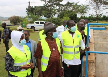 NWSC Board Chairman Eng. Dr. Badru Kiggundu leads members on a recent tour of some of the corporation's projects. Officials say allegations of impropriety in some procurements are far fetched (PHOTO/File).