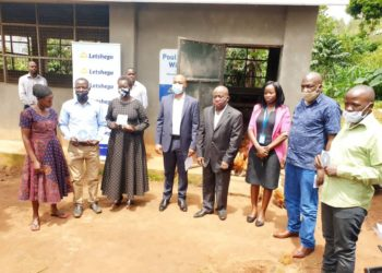 Regional farmers take a group photo with Giles Aijukwe CEO Letshego and Letshego board director Peter Masaba (Center) during ILC Poultry project handover in Wakiso district (PHOTO/Courtesy).