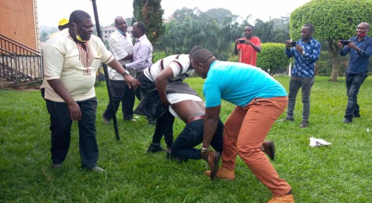 Some of the party members fighting during the party reconciliation meeting at Grand Parolos Hotel in Mukono municipality on Monday (PHOTO/Courtesy).
