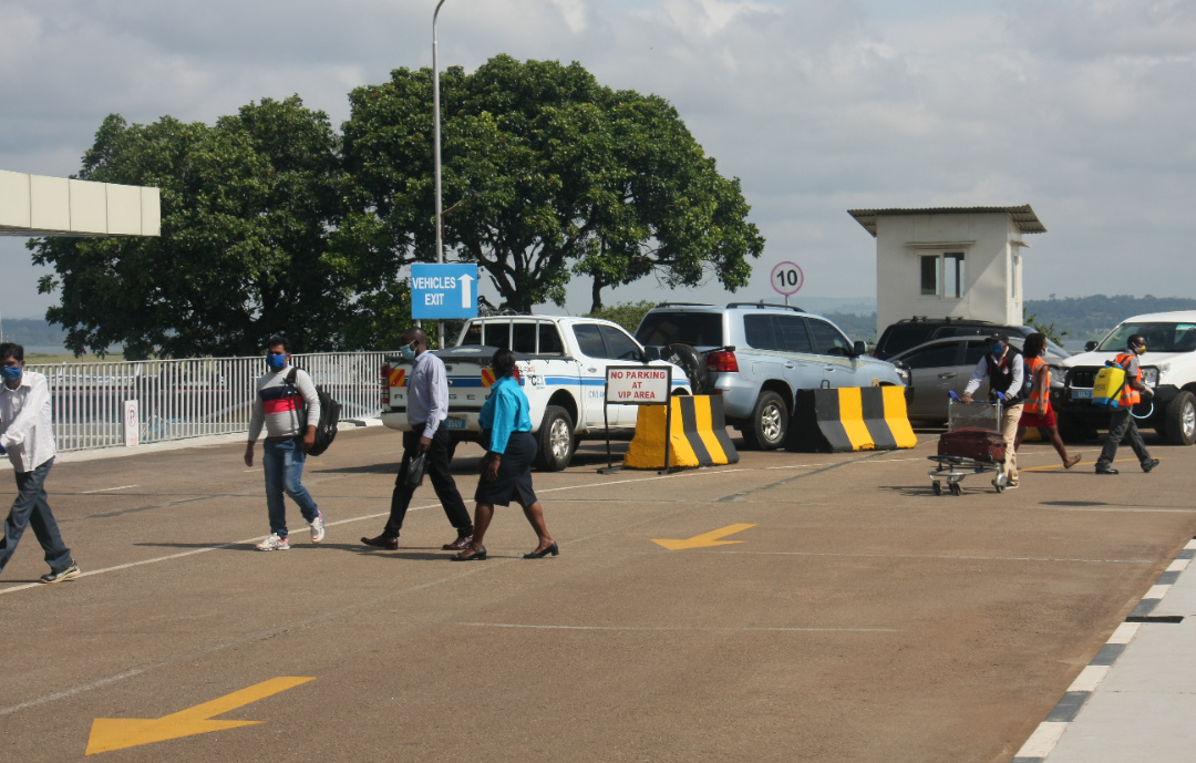 UCAA staff observe as intending travelers arrive at the departure terminal on Thursday (PHOTO/Courtesy).