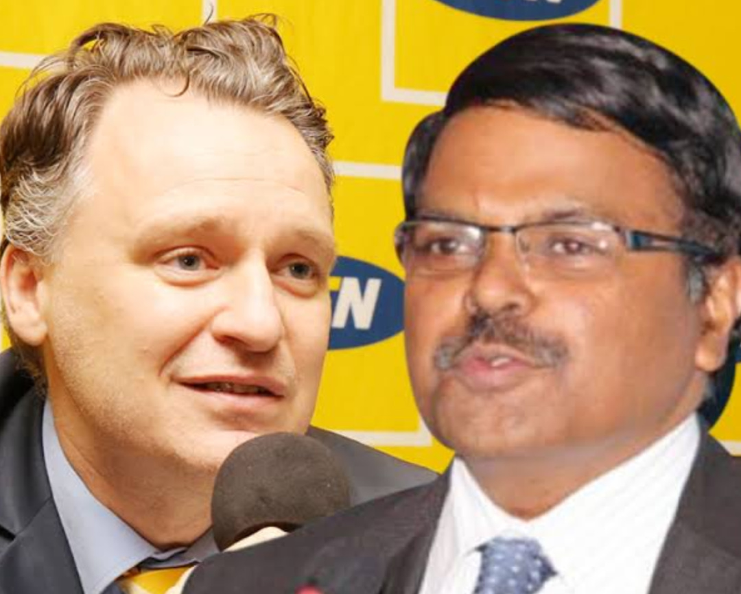MTN Uganda and Airtel Uganda Executive Directors Wim Vanhelleputte and VG Somasekhar  respectively (PHOTO/File).