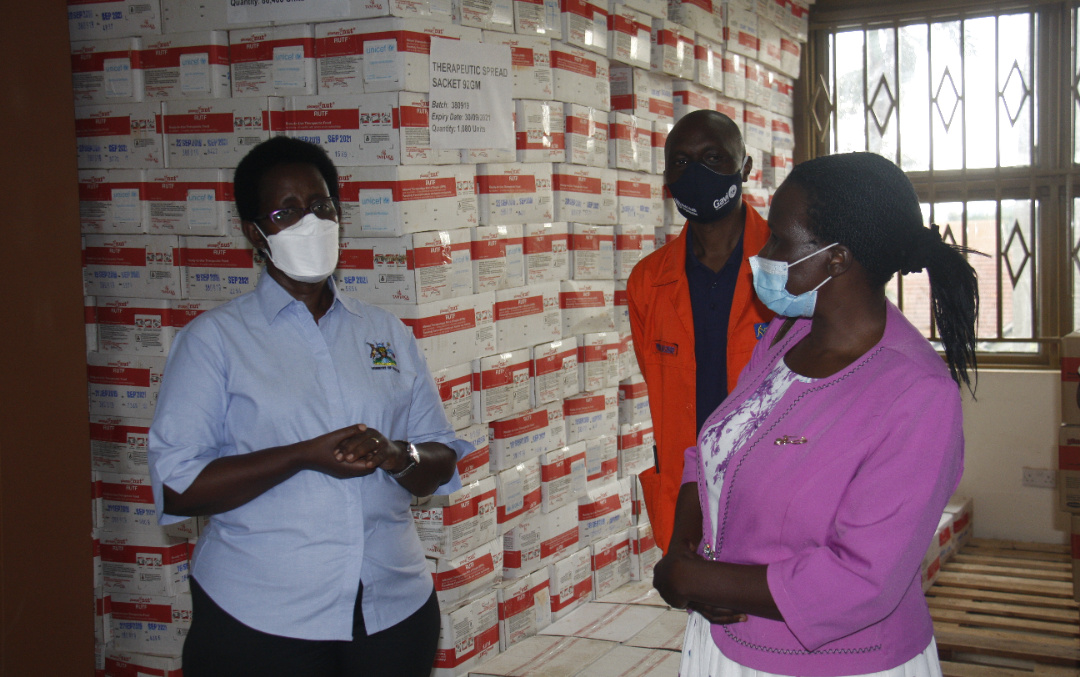 The Permanent Secretary, Ministry of Health Dr. Diana Atwine (L) inspects part of the nutritional commodities at the NMS stores in Entebbe (PHOTO/PML Daily).