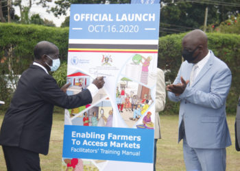 The Vice president Mr Edward Sekandi signs on a training manual for facilitators as Minister for Agriculture, Animal Industry and Fisheries (MAAIF) Mr Vicent Ssempijja observes on Friday (PHOTO/PML Daily).