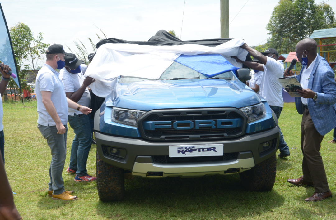 Mr Paul Kavuma, the chief Engineer at Ministry of Works and CMC Country Manager Mr Mark Davidson unveiling the Ford Raptor yesterday at Busika Extreme Adventure Park in Gayaza (PHOTO/PML Daily).