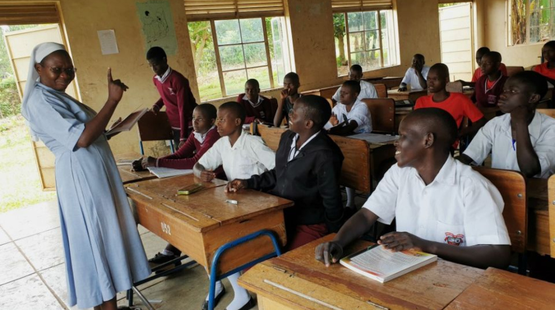 Sr. Rose Nelima interacts with students at Mbale School for the Deaf in Uganda (PHOTO/Gerald Matembu).