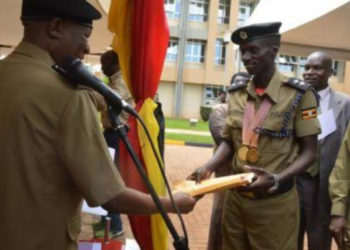 Police boss Martin Okoth Ochola honouring Athletics World record breaker Cheptegei Joshua (PHOTO/Courtesy).