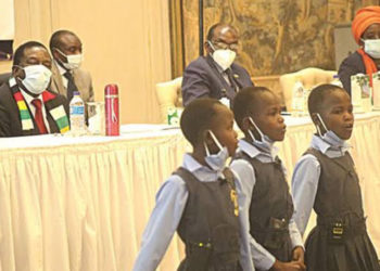 President Mnangagwa, Vice President Kembo Mohadi and Industry and Commerce Minister Dr Sekai Nzenza watch as triplets Tanyaradzwanashe, Anesuishe and Ruvarashe Chandavengerwa (10) make a presentation on consumer awareness during the launch of the Consumer Protection Act in Harare (PHOTO/Courtesy).