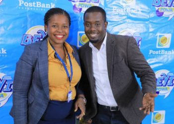 Ms. Doreen Nyiramugisha, the Head of Marketing and Communication at PostBank Uganda and Mr. Richard Tuwangye during the launch of PostBank's Digital Banking Beyi Powa campaign recently in Kampala (PHOTO/Courtesy).