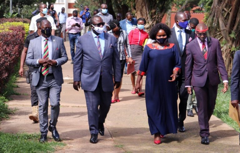 L-R: The Vice Chancellor-Prof. Barnabas Nawangwe, Owek. Robert Waggwa Nsibirwa, Dr. Prosperous Nankindu Kavuma, Dr. Umar Kakumba and Owek. Noah Kiyimba (2nd Row Right) make their way past the Main Library to the Main Building site (PHOTO/Courtesy).