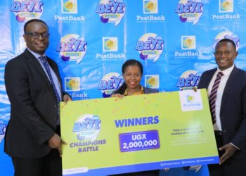 Mr. Julius Kakeeto, the Managing Director, Ms. Doreen Nyiramugisha, the Head of Marketing and Communication and Mr. Andrew Agaba, the Chief Business Officer of PostBank Uganda display the prize of the winner of the Beyi Powa Champions Battle during the launch of their Digital Banking (PHOTO/PML Daily).