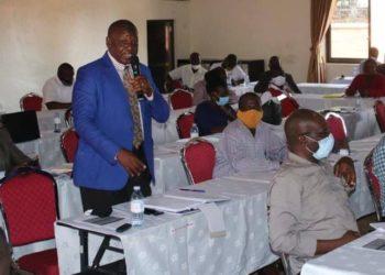 Busia (Uganda) Resident District Commissioner Capt Chris Mike Okirya makes a contribution (PHOTO/Courtesy).