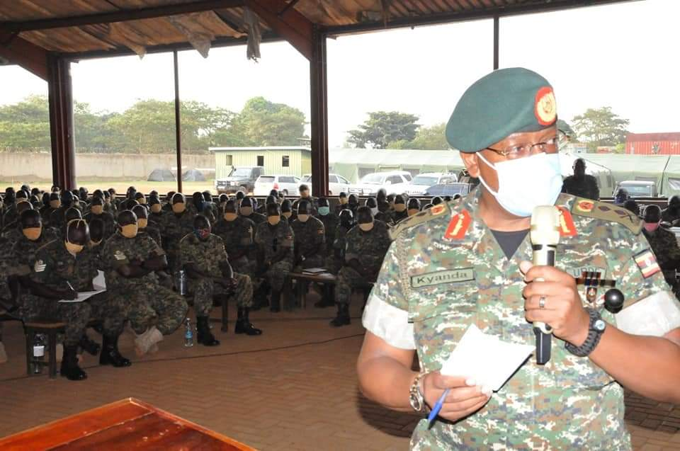 Chief of Staff Land Forces, Maj Gen Leopold Kyanda addressing the returnees (PHOTO/Courtesy).