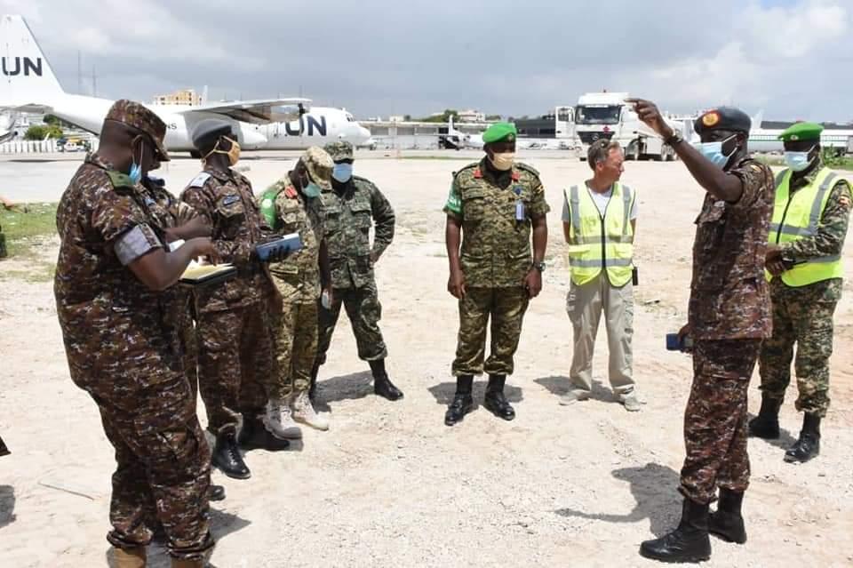 Maj Gen Charles Okidi visiting AMISOM troops in Somalia (PHOTO/Courtesy).