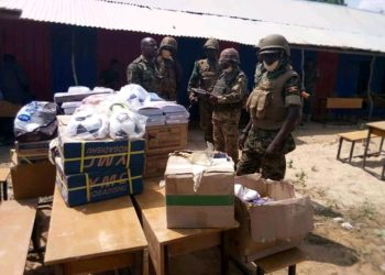 Officers parade some of the scholastic items donated by the UPDF to Embresso Primary School in Somalia (PHOTO/Courtesy).