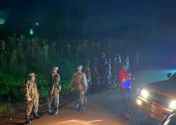 Footage posted on the Bobi Wine's Facebook account showed dozens of military officers wearing helmets and carrying guns and batons surrounding the presidential candidate's hotel recently (PHOTO/Courtesy)