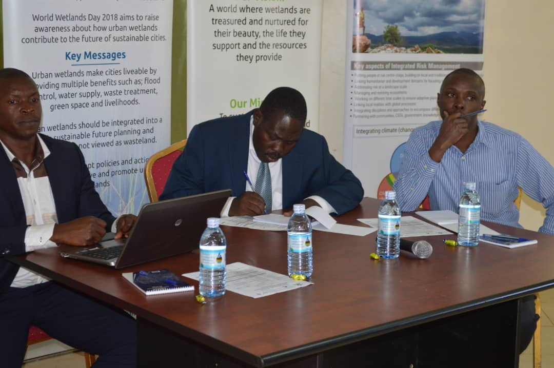 L-R Mr. Richard Kyambadde, Mr. Joseph Ongol of Wetlands Department during consultations on the wetlands policy and Bill. Extreme right is Mr. Anthony Wolimbwa who represented Partners for Resilience (PHOTO/Courtesy).