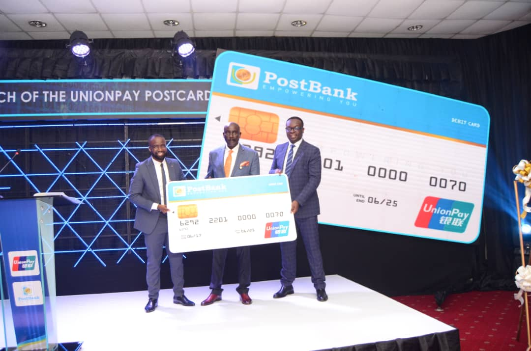 L-R: Mr. Julius Kakeeto, the Managing Director PostBank Uganda, Dr. Tumubweine Twinemanzi, the Executive Director Supervisions, Bank of Uganda and Mr. Jonathan Mwesigwa, the Business Development Manager East & Africa: Uganda, UnionPay International during the launch of the UnionPay PostCard at Kampala Serena Hotel (PHOTO/Courtesy).