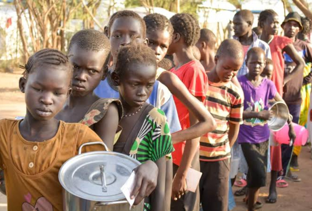 Children in South Sudan line up for some food (PHOTO/Courtesy).