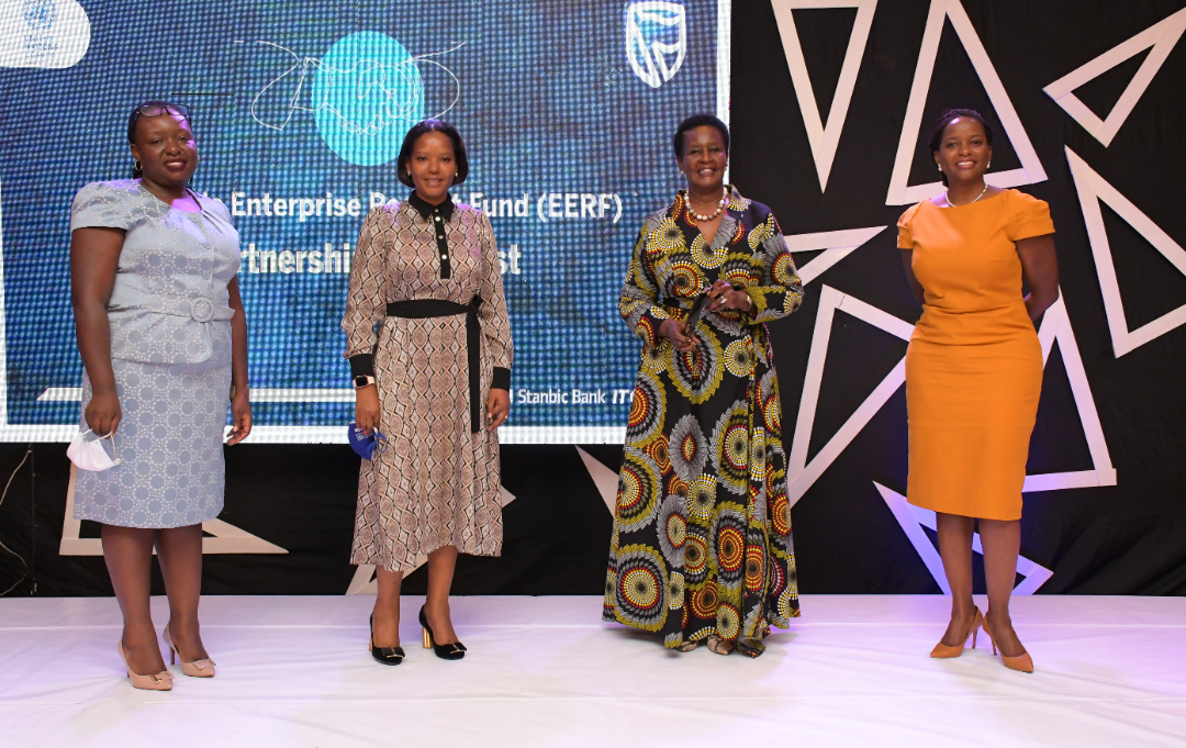 LR: Ms. Emma Mugisha the Executive Director of Stanbic Bank, Ms. Grace Muliisa the Head of Personal and Business Banking of Stanbic Bank, Hon. Amelia Kyambadde Minister of Trade, Industry and Cooperation and Ms. Anne Juuko Chief Executive Officer of Stanbic Bank posing for a picture at the launch (PHOTO/PML Daily).