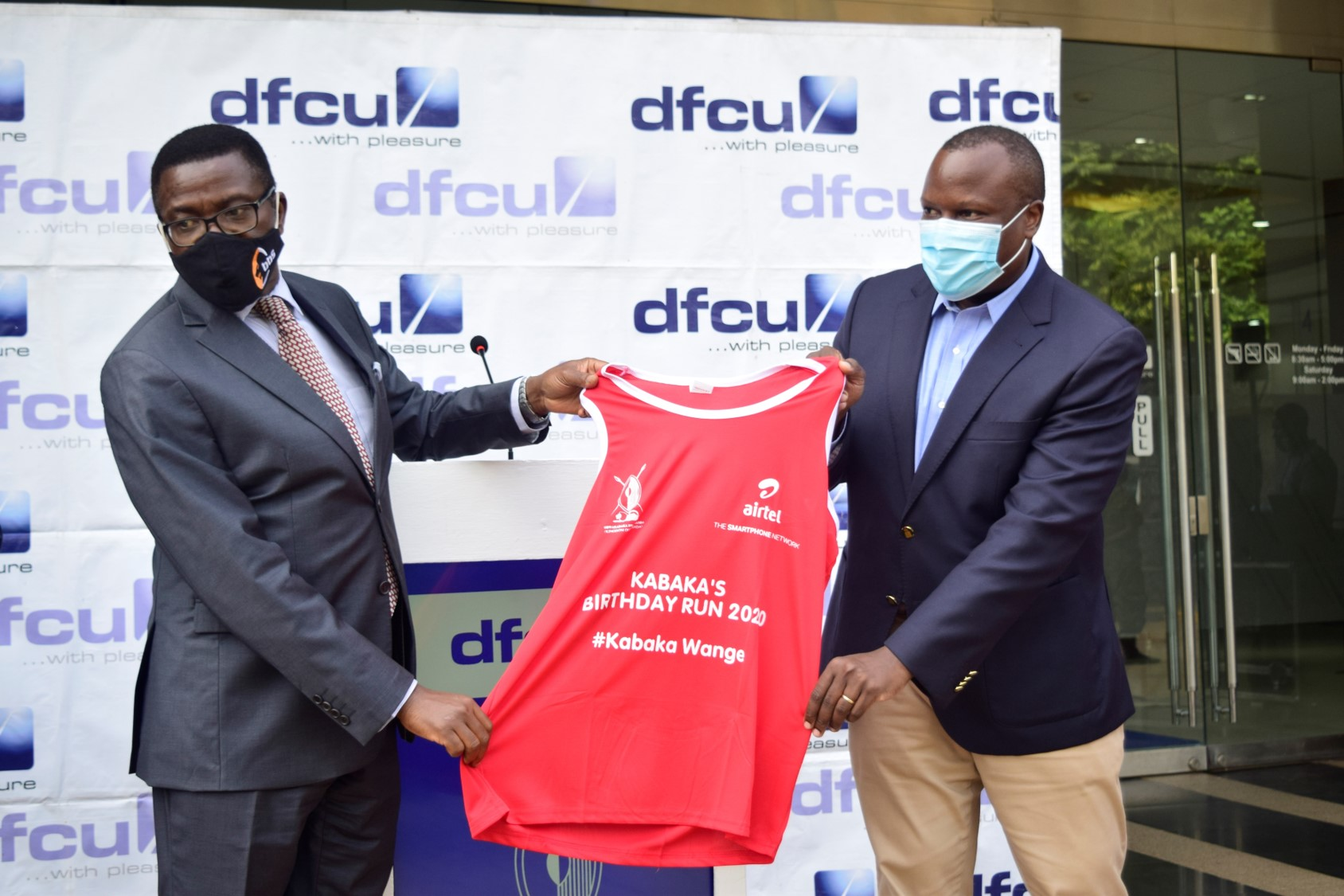 Katikkiro of Buganda, Owek. Charles Peter Mayiga with the dfcu Bank CEO Mathias Katamba (PHOTO/Courtesy)