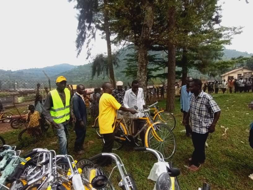 Mr Mukhobeh, the NRM flag for Manjiya constituency gives out a bicycle to an LC at Bududa district headquaters (PHOTO/David Mafabi).