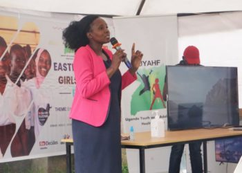 Ms. Akong Marry the Senior Education officer and focal point the Girl child in Tororo District giving her remarks at the Easter Region Girl Summit in Mbale