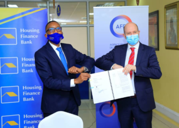 The Managing Director, Housing Finance Bank Uganda, Michael Mugabi and Hatem Chakroun, the Agence Française de Développement (AFD) country Director in Uganda, have signed two financing agreements to the tune of euro 10.5 million (PHOTO/Courtesy).