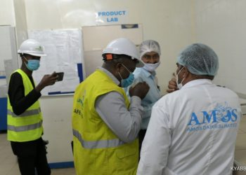 Umeme Managing Director Selestino Babungi on a guided tour of Amos Dairies one of the large power consumers in Western Uganda (PHOTO/Courtesy)