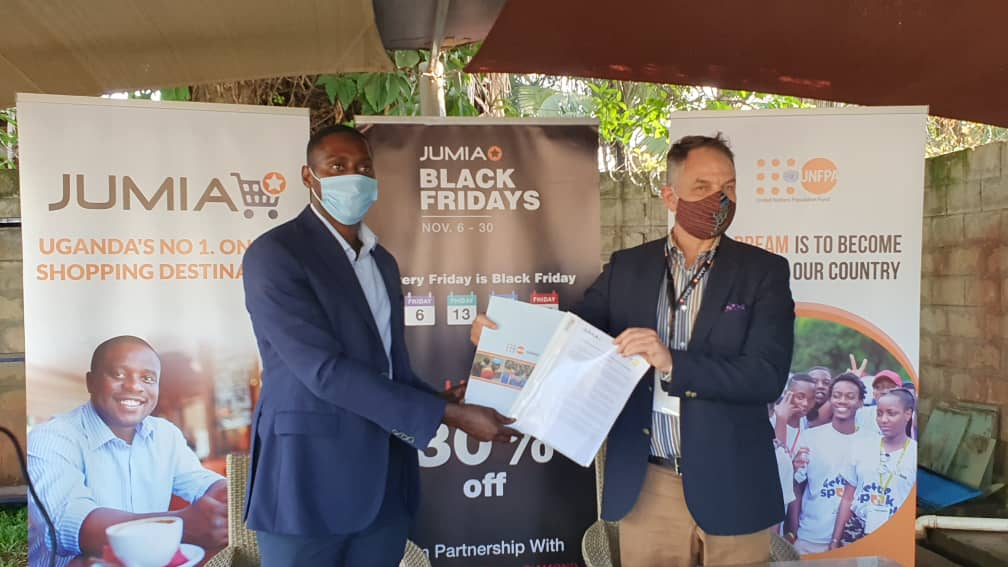 Ron Kawamara, the Chief executive officer of Jumia Uganda and Mr. Alain Sibenaler, the UNFPA Representative in Uganda (PHOTO/Courtesy) .