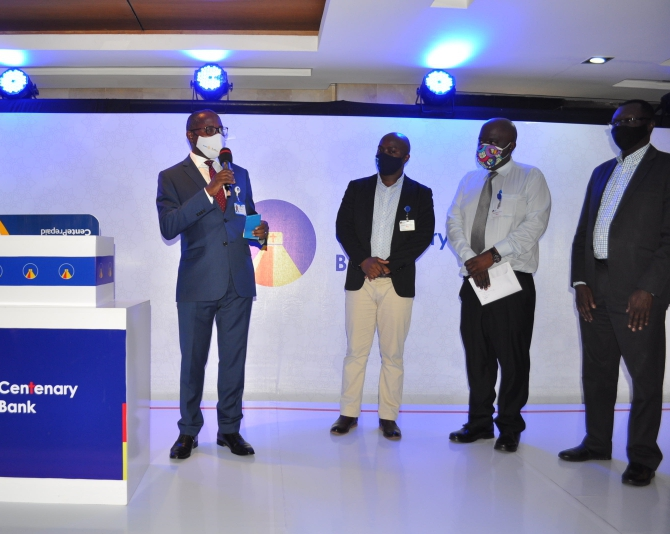 Fabian Kasi (L) Centenary Bank's Managing Director displaying the CenteVisa Prepaid Card, in the company of some of the bank's partners. This was during the launch of the CenteVisa Prepaid Card at Centenary Bank Head Office at Mapeera House in Kampala (PHOTO/Courtesy).