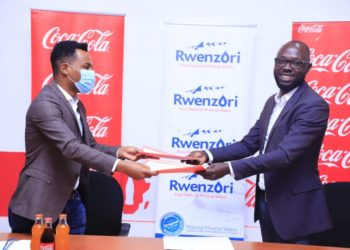 Benjamin Rukwengye, Founder and Chief Executive of Boundless Minds joins Melkamu Abebe, Head of Coca-Cola Beverages Africa in Uganda to launch the Elevate! youth mentorship program (PHOTO/Courtesy).