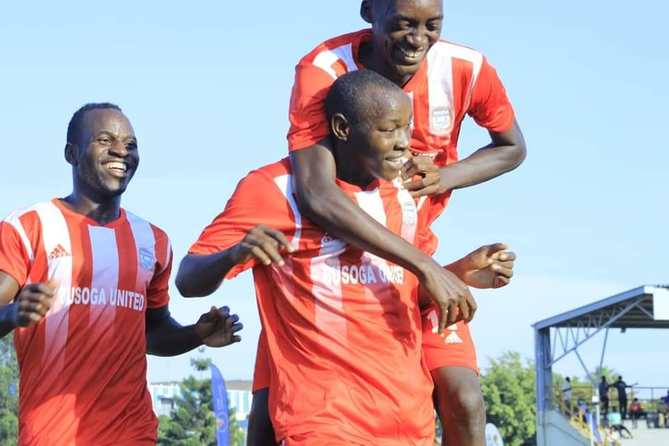 Busoga United FC players celebrate after taking the lead against Kyetume FC on Friday, December 11. (PHOTO/COURTESY)