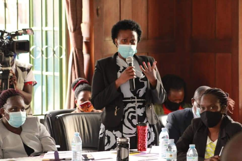 One of the Chief Registrars posing a question during a meeting with CR Sarah Langa Siu on Friday (PHOTO/Courtesy).
