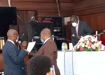 Justice Albert Rugadya Atwooki (L) being sworn in as the chairperson of the Citizenship and Immigration Board (PHOTO/Courtesy).