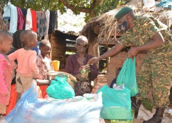 Lt David Kamya delivering the Christmas hampers to a blind family on Tuesday (PHOTO/Courtesy).