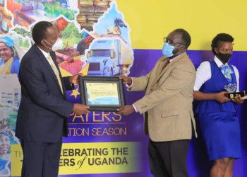 URA chief John Musinguzi handsover one of the awards to NWSC (PHOTO/Courtesy).