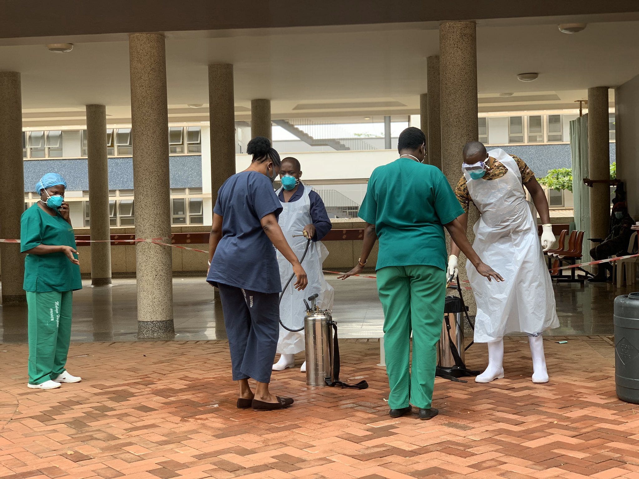 Health workers at Mulago Specialised National Hospital undergo disinfection upon leaving the COVID-19 isolation and treatment unit (PHOTO/PML Daily).