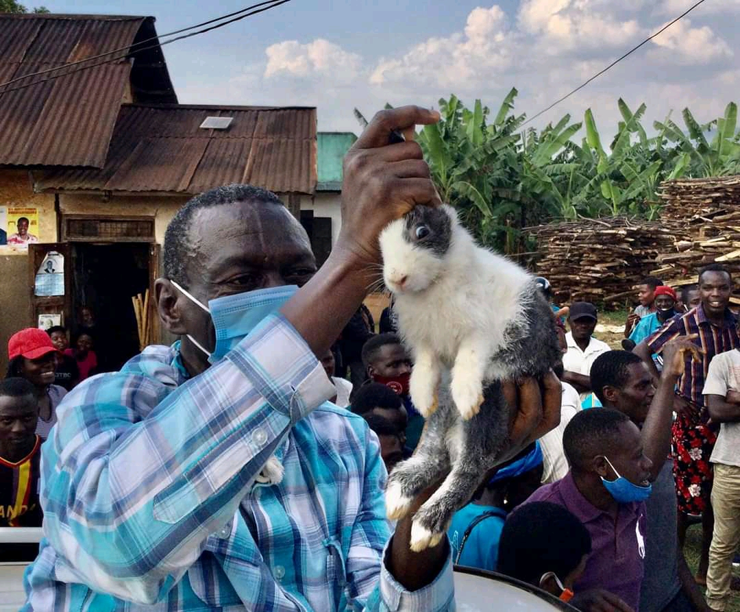 Dr Kizza Besigye given a gift of a rabbit in Sheema district (PHOTO/Courtesy).