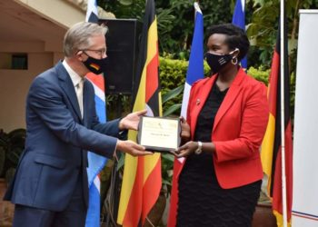 Uganda Law Society President Ms. Pheona Nabasa Wall receiving an award from Germany Ambassador to Uganda Matthias SCHAUER (PHOTO/Courtesy).
