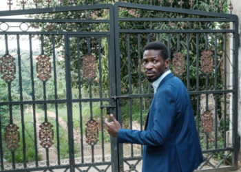 Ugandan opposition leader Bobi Wine at the gate of his home, which soldiers have surrounded after he alleged mass electoral fraud (PHOTO/Courtesy).