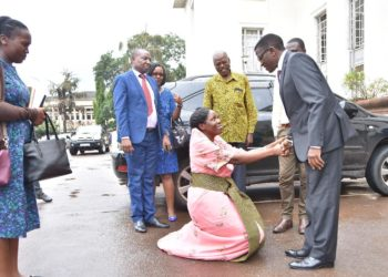 Information Minister Judith Nabakooba who as defeated by NUP's Joyce Bagala greets Katikkiro Mayiga recently (PHOTO/File)