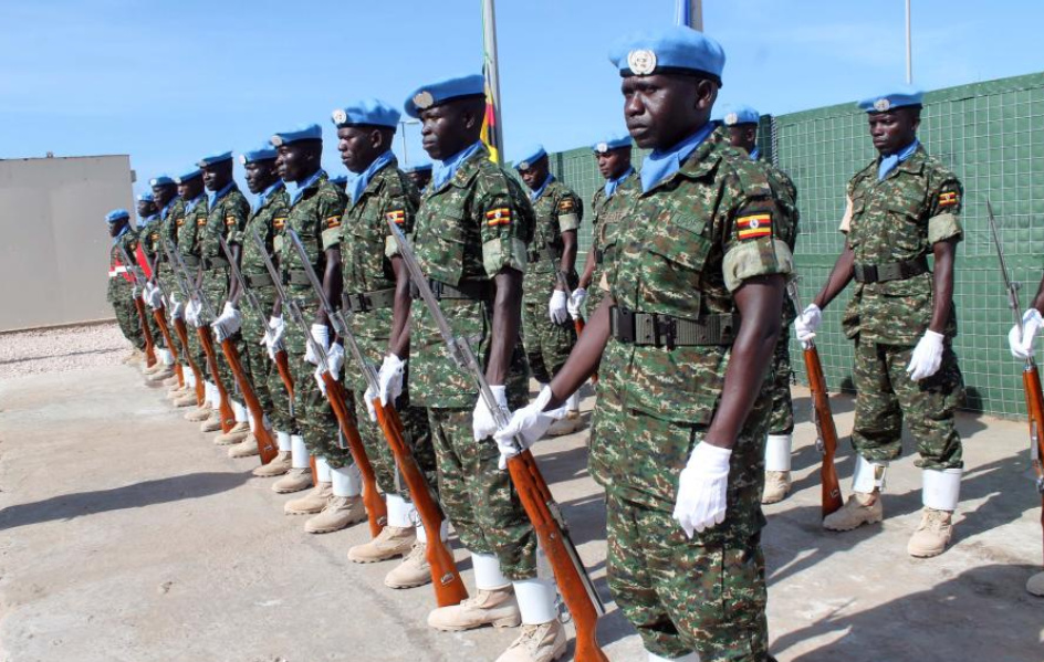 File photo shows Soldiers stand guard during the formal inauguration ceremony of the United Nations Guard Unit (UNGU), a defensive military enity mandated to protect UN staff and installations in Mogadishua, capital of Somalia, May 18, 2014 (Xinhua/Faisal Isse).