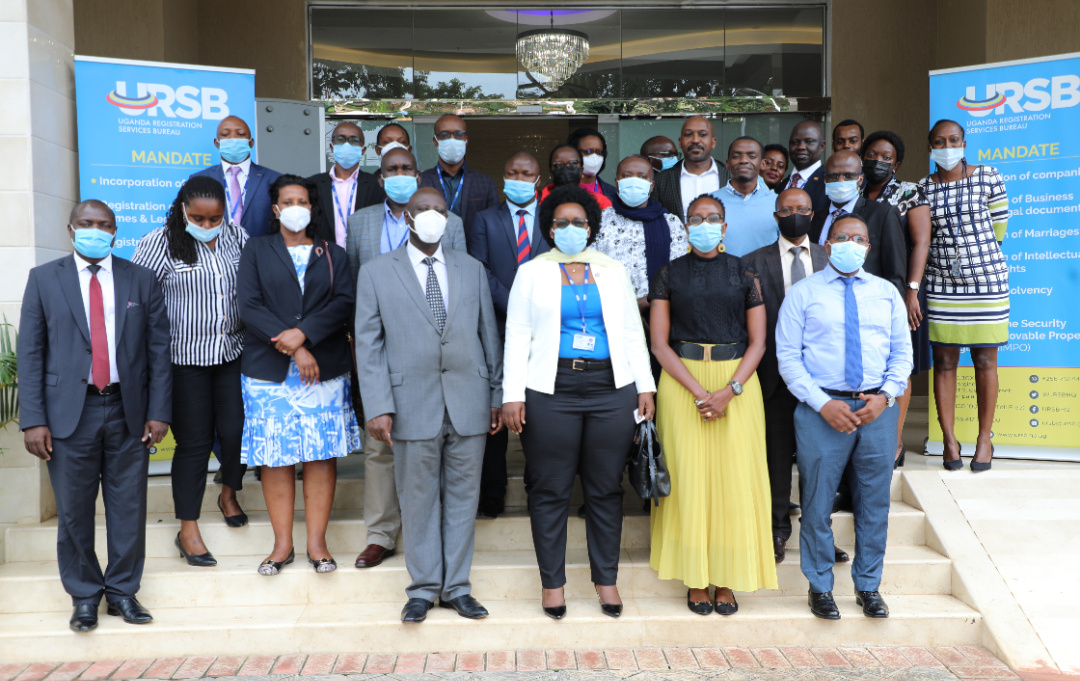 Merck K. Kainobwisho, the Registrar General (Front Row 2nd L) in a group photo with the URSB Senior Management team during the strategy retreat (PHOTO/Courtesy).