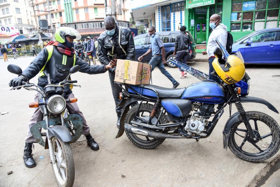 Moses Otieno prepares to send a delivery to his client in Nairobi, Kenya, on Jan. 22, 2021. (Xinhua/John Okoyo)